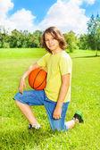 Boy with basketball posing — Stock Photo