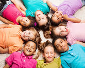 Group of eight happy kids in star shape — Stock Photo