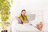 Smiling girl with laptop — Stock Photo