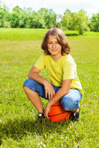 Basketball player after game rest on grass — Stock Photo