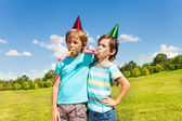 Boys making noise on birthday party — Stock Photo