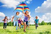 Many active kids with kite — Stock Photo