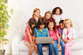 Kids watch movie from laptop — Stock Photo