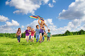 Many kids have fun with kite — Stock Photo