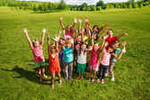 Huge group of kids in the park — Stock Photo