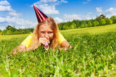 Blowing in party noisemaker whistle — Stock Photo