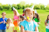 Boy on birthday with friends — Stock Photo