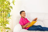 Reading books on the couch — Stock Photo
