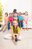 Little girl with TV remote control — Stock Photo