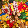 Kids lay on the autumn grass — Stock Photo