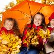 Girls under umbrella — Stock Photo