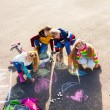 Friends drawing with chalk — Stock Photo