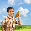 Happy boy with paper plane — Stockfoto