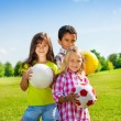 Happy kids with balls — Stock Photo