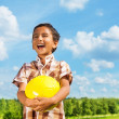Stock Photo: Laughing boy with ball