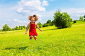Girl jumping over the rope — Stock Photo