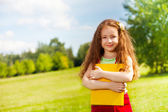 Girl standing in the park — Stock Photo