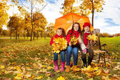 Girls under umbrella — Stock Photo