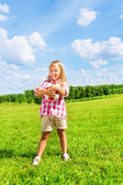 Little girl holding football ball — Stock Photo