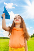Girl with paper plane — Stock Photo