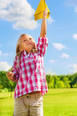 Child with paper plane — Stock Photo