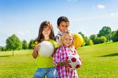 Happy kids with balls — Stock Photo