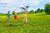 Kids with kite — Stock Photo