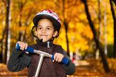 Boy in autumn park — Stock Photo