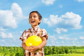 Laughing boy with ball — Stock Photo