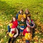 Kids on autumn lawn — Stock Photo #36200009