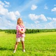 Stock Photo: Girl in field with ball