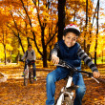 Boy on bike ride — Stock Photo