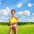Stock Photo: Boy with volleyball ball in park