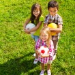 Kids team with sport balls — Stock Photo