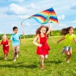Kids run with kite — Stock Photo #36200541
