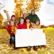 Happy kids with blank placard — Stock Photo