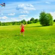 Girl running with kite — Stock Photo
