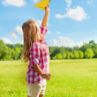 Happy child throw paper plane — Stock Photo