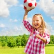 Stock Photo: Laughing girl throwing ball