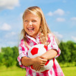 Laughing girl with ball — Stock Photo