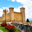 Bolsena castle and flower beds — Stock Photo