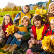 Kids on autumn lawn — Stock Photo