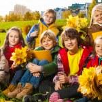 Kids on autumn lawn — Stock Photo #36201305