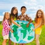 Kids with globe map — Stock Photo #36201625