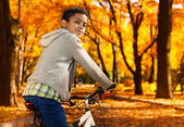 Boy in autumn park — Stock Photo