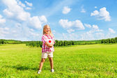 Girl in the field with ball — Stock Photo