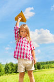 Girl throwing paper plane — Stock Photo