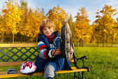 Boy on the bench — Stock Photo