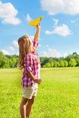 Happy child throw paper plane — Stock Photo