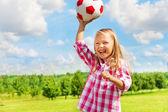 Laughing girl throwing ball — Stock Photo